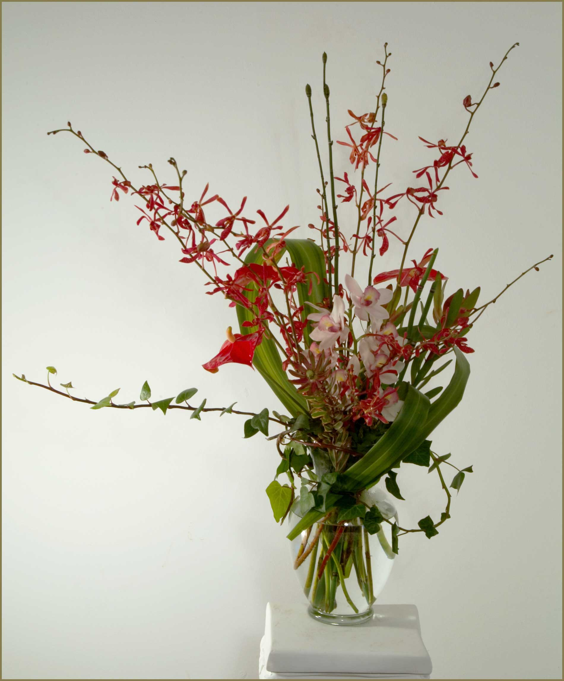 Orchid basket arrangements tropicals yukiko 39 s floral design for A arrangement florist flowers