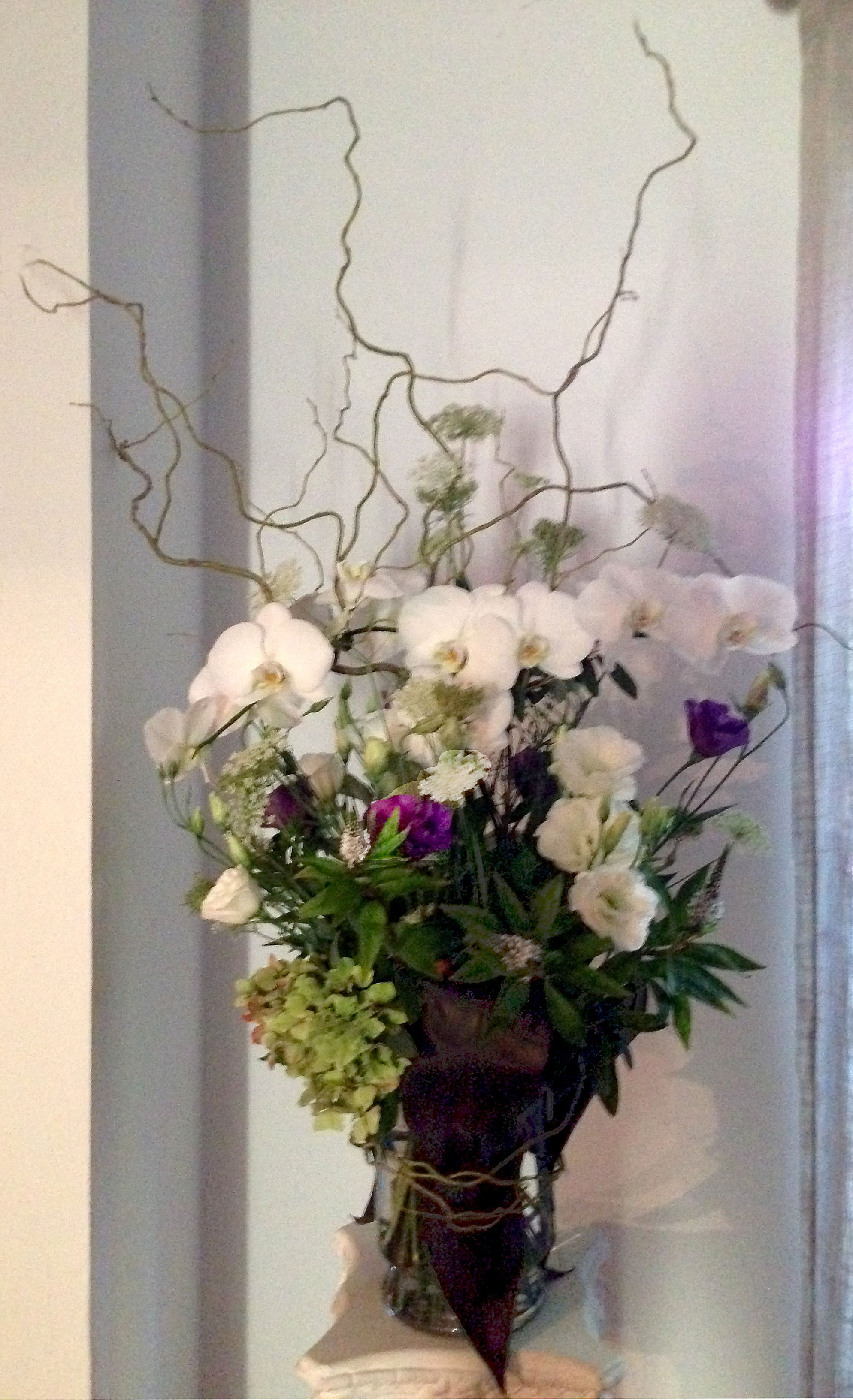 Sympathy flower arrangements by yukiko memorial bouquet with phalaenopsis lisianthus and queen annes lace wrapped with ti leaves and curly willow 350 funeral wreaths izmirmasajfo Image collections