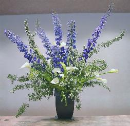 Blue delphinium bouquet creates soft, gentle mood.