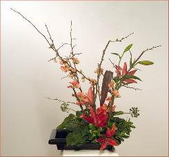 red flowering quince ikebana with lilies
