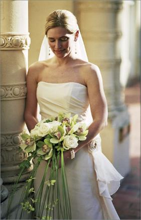 Bride with cascading bouquet at wedding in San Rafael