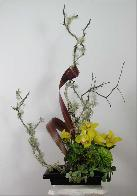 Ikebana with seasonal flowers and branches