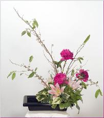 peony ikebana with lilies and branches
