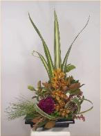 Dramatic, fulsome ikebana floral design roses orchid